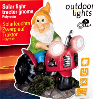 Solarleuchte Gartenzwerg auf rotem Traktor